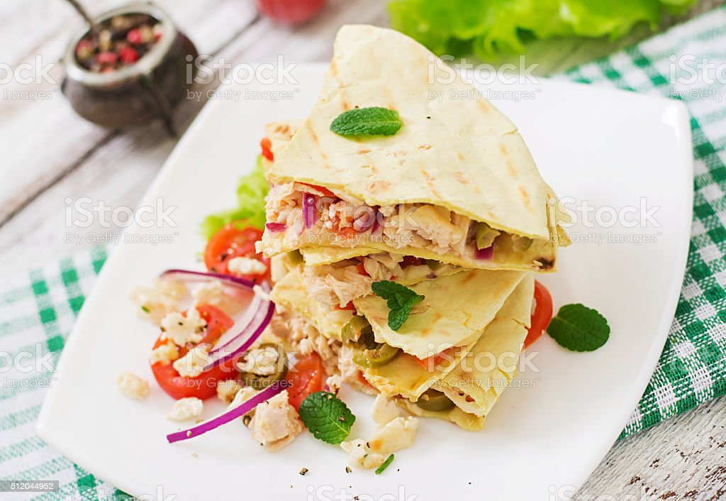 Mexican Quesadilla wrap with chicken, olives, sweet pepper stock photo