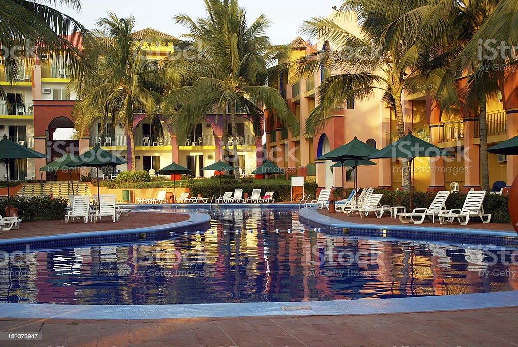 Mexican Resort Pool in early evening royalty-free stock photo