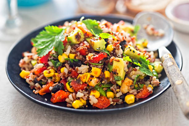 mexican rice, quinoa avocado salad with chilli dressing - quinoa stock photos and pictures