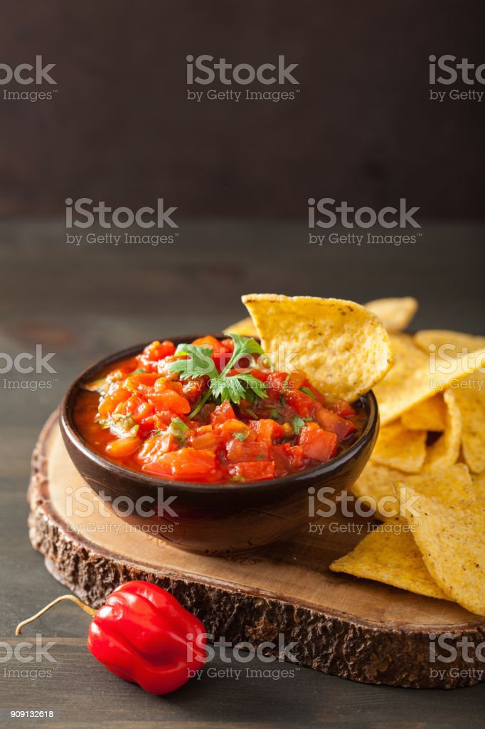 mexican salsa dip and nachos tortilla chips stock photo
