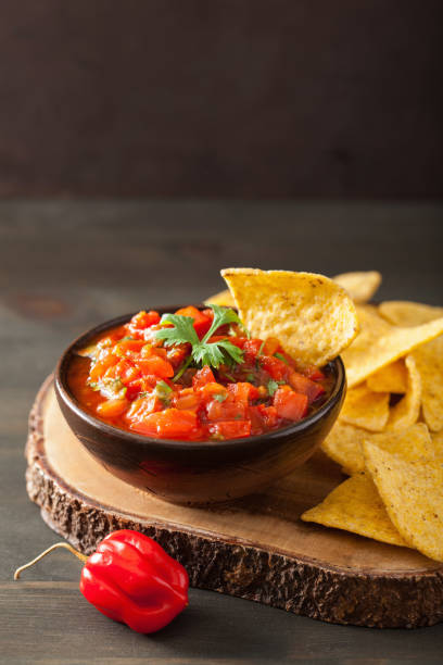 mexican salsa dip and nachos tortilla chips mexican salsa dip and nachos tortilla chips salsa sauce stock pictures, royalty-free photos & images