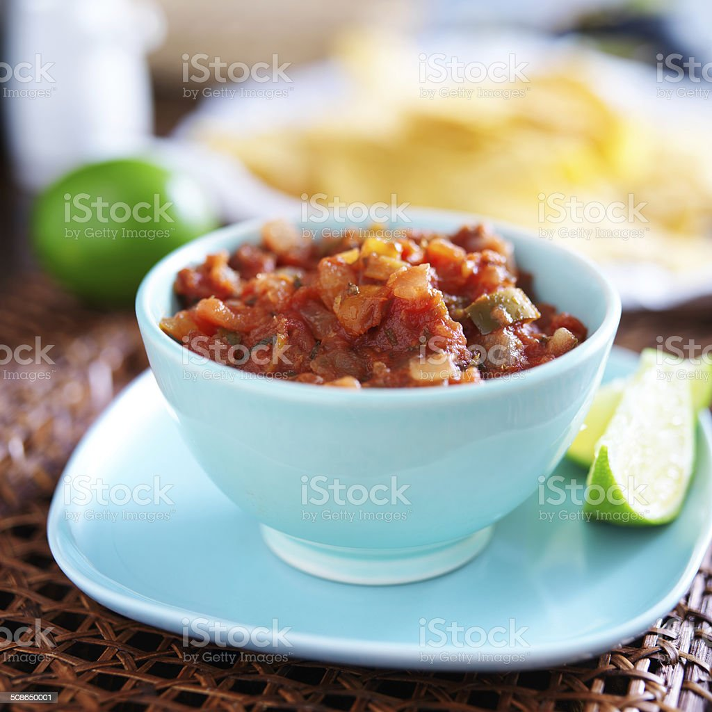 mexican salsa in blue bowl stock photo