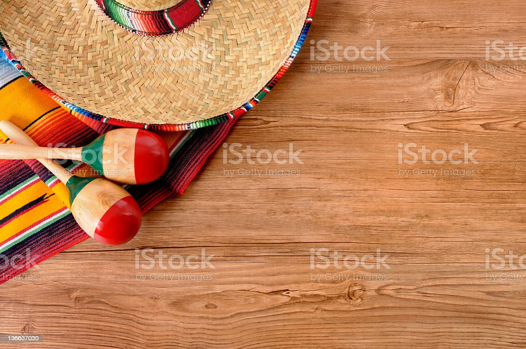 Mexican sombrero and blanket on pine wood floor royalty-free stock photo