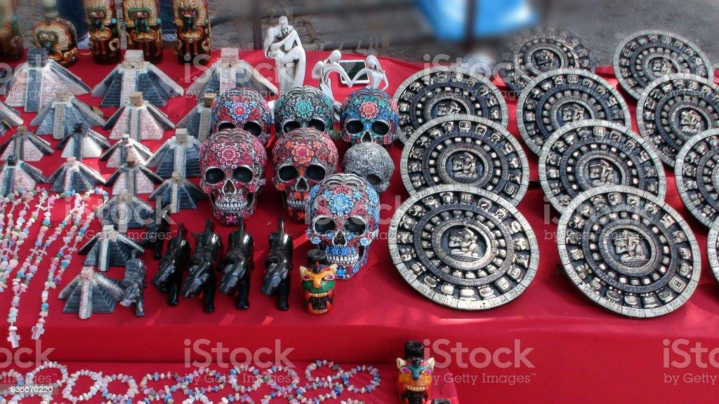 Mexican Souvenir Aztec Calendar, Skull, Chichen Itza, Jewellery And Scene In Yucatan Mexico stock photo