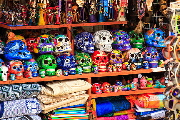 Mexican souvenirs Colorful skulls souvenirs in Playa del Carmen, Mexico craft product stock pictures, royalty-free photos & images