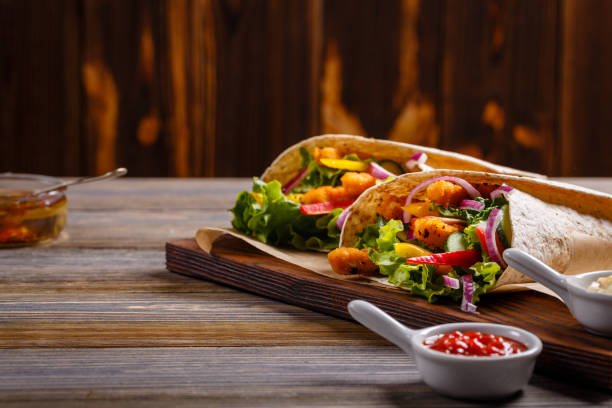 Mexican special: Tortilla with chicken and vegetables. stock photo