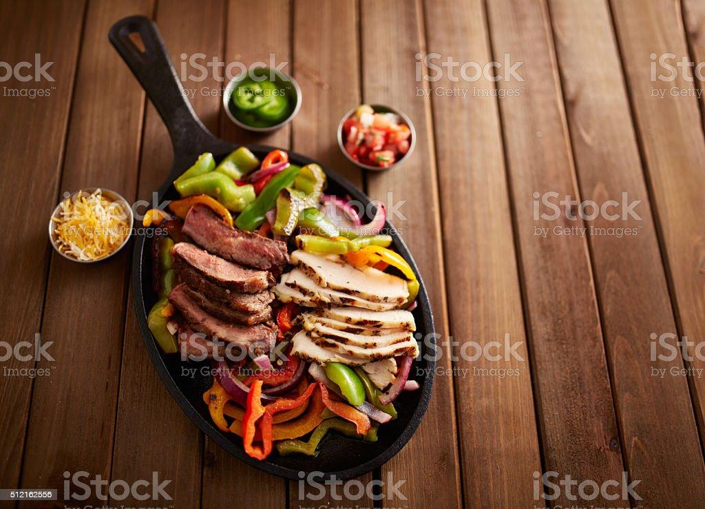 mexican steak and chicken fajitas stock photo
