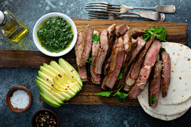 Mexican steak with avocado and green sauce stock photo