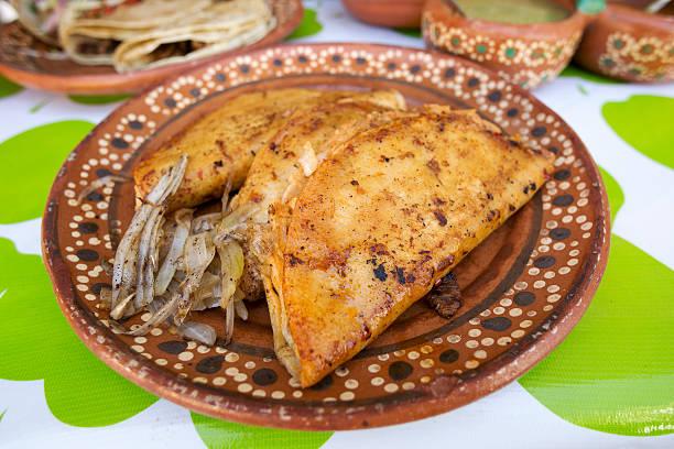 Mexican street food fried quesedilla stock photo