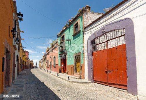 Colonial buildings along a cobblestone street in the town of San Miguel de Allende. San Miguel was named a Pueblo Magico, a magic village.