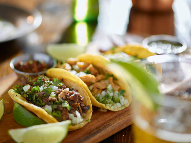 mexican street tacos and beer - mexican food stock photos and pictures