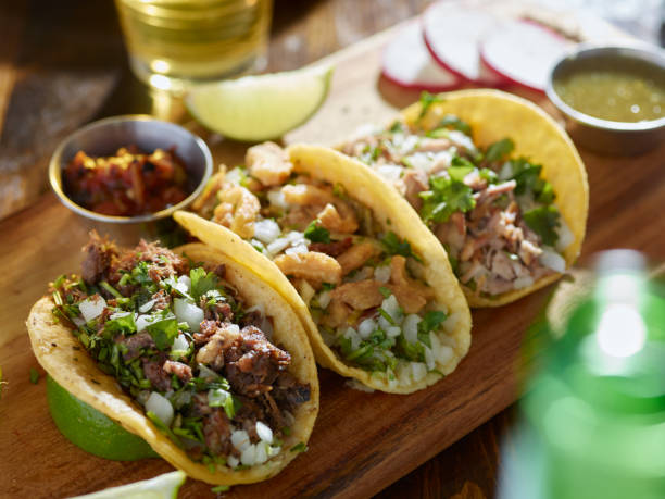mexican street tacos with barbacoa, carnitas and Chicharrón mexican street tacos with barbacoa, carnitas and Chicharrón shot with selective focus taco stock pictures, royalty-free photos & images