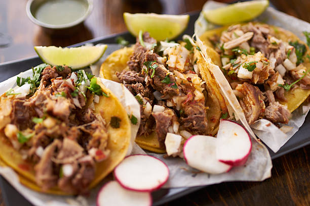 mexican street tacos with chicken, carnitas and barbacoa - mexican food stock photos and pictures