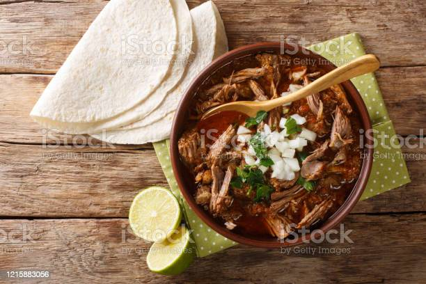 Mexican Style Slow Cooked Beef Stew Birria De Res Served With Lime And Tortilla Closeup In A Bowl Horizontal Top View Stock Photo - Download Image Now