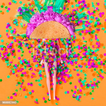 1125575680 istock photo Mexican Taco of flowers instead of a head of the doll which lies among of a confetti pinata. 968882860