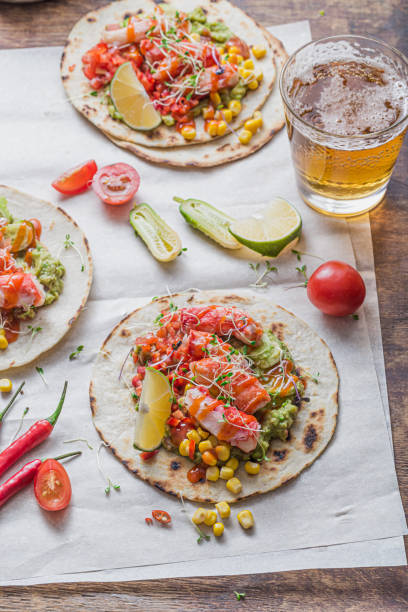 Mexican tacos with crab meat, avocado, corn and salsa stock photo