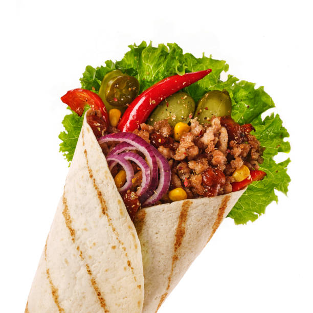 Cтоковое фото Mexican tacos with filling beef, jalapeno, onion, pickles and corn. Delicious Tortilla with minced meat, onion, pepper and cucumbers.