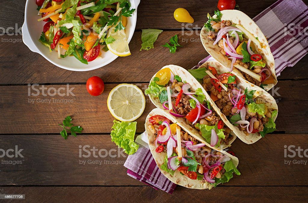 Mexican tacos with meat, beans and salsa stock photo