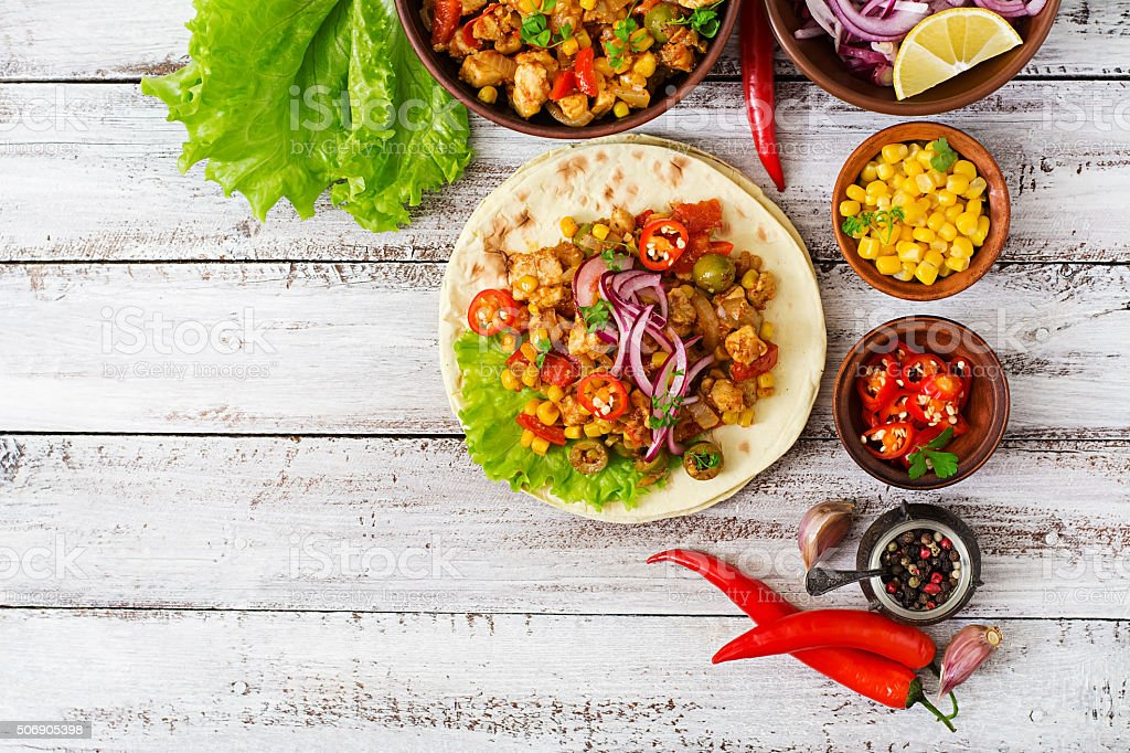 Mexican tacos with meat, corn and olives stock photo