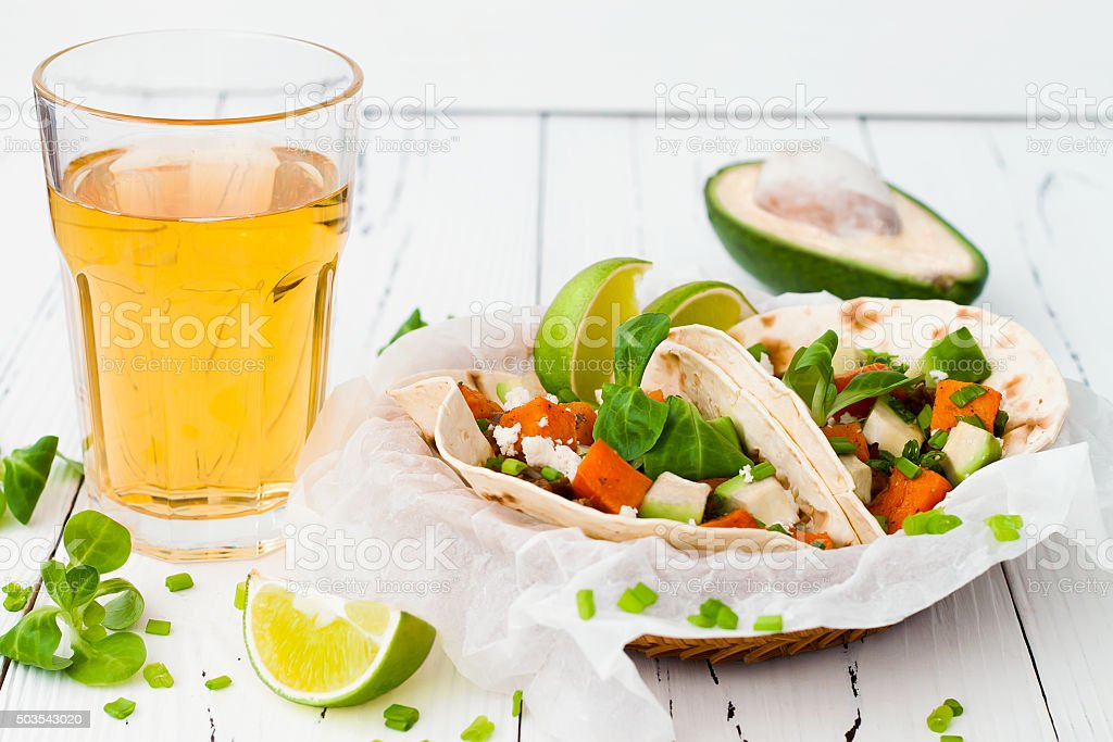 Mexican tacos with meat, sweet potatoes and cotija cheese stock photo