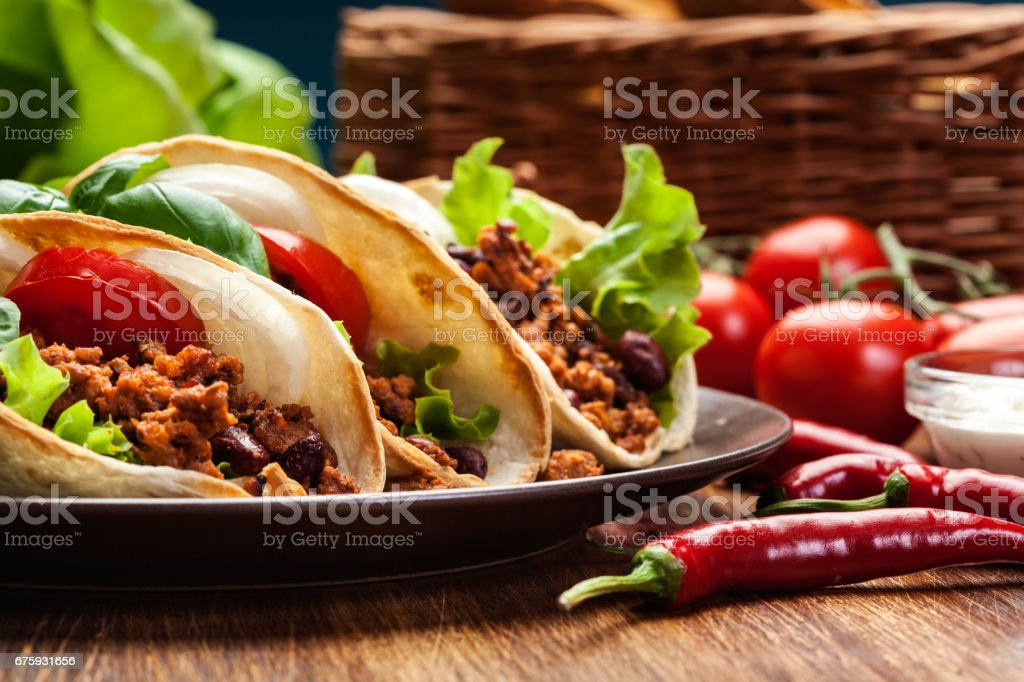 Mexican tacos with minced meat, beans and spices stock photo