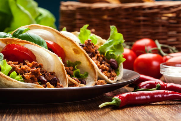 mexican tacos with minced meat, beans and spices - mexican food stock photos and pictures