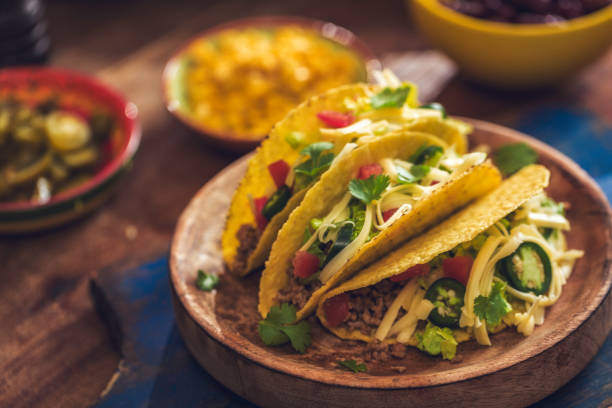 mexican tacos with spicy salsa, minced meat and guacamole - taco foto e immagini stock