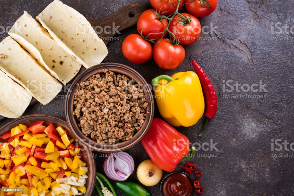 Mexican tacos with vegetables and meat. Ingredient for cooking tacos al pastor on concrete background. Top view stock photo