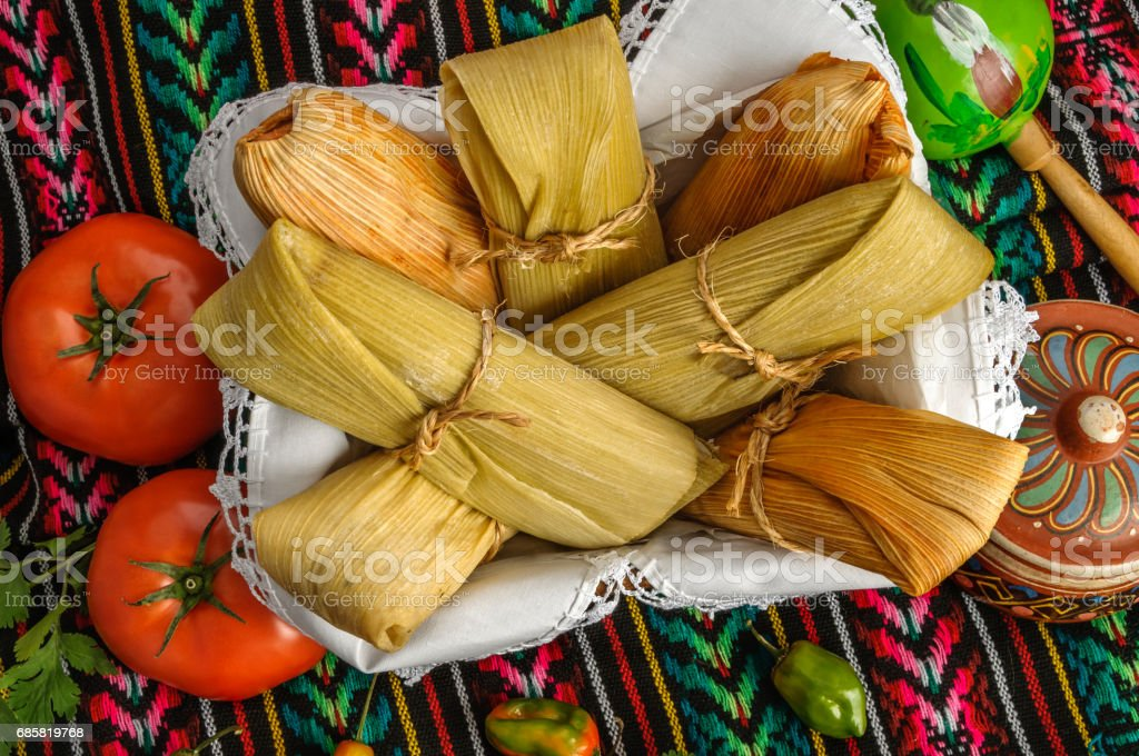 Mexican tamales made of corn and chicken stock photo