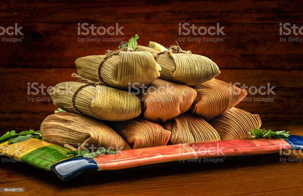 Mexican tamales made of corn chicken pork and chili stock photo