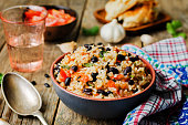 Mexican tomato black beans rice with cilantro. toning. selective focus