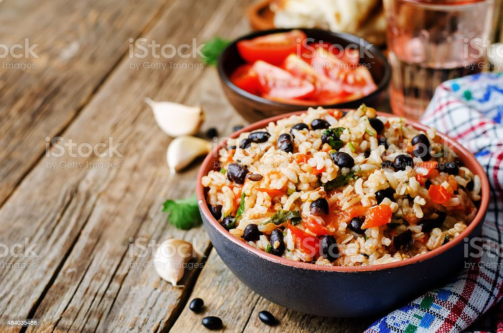 Mexican tomato black beans rice with cilantro stock photo