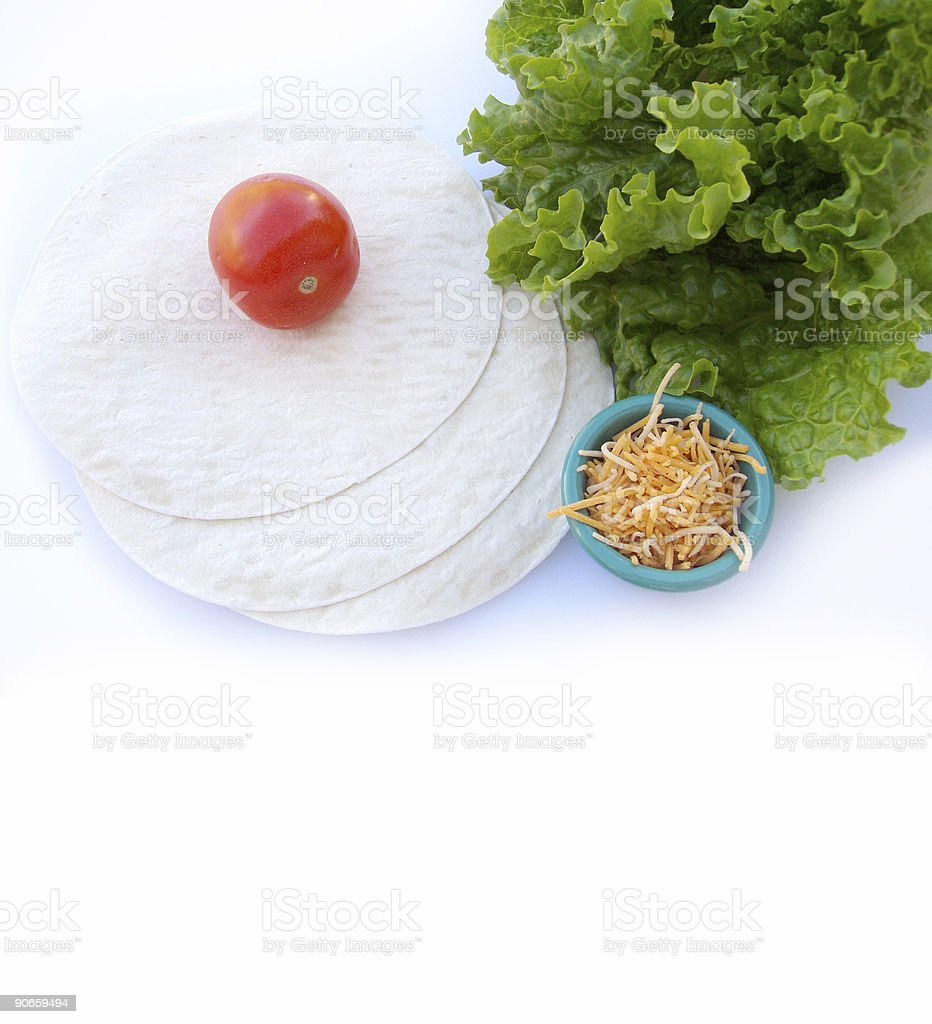 Mexican Tortillas, Lettuce,Tomato and shredded cheese royalty-free stock photo