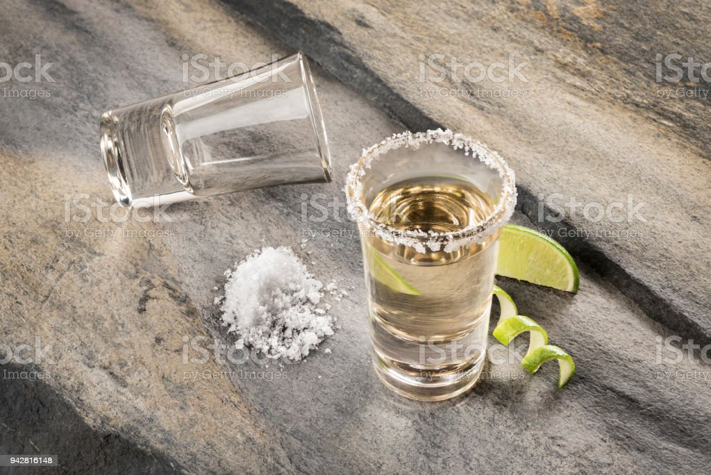 Mexican traditional drink accompanied with lime and salt stock photo