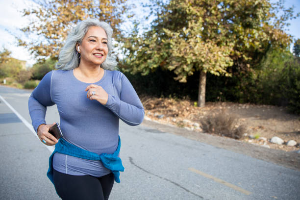 Mexican Woman Jogging stock photo