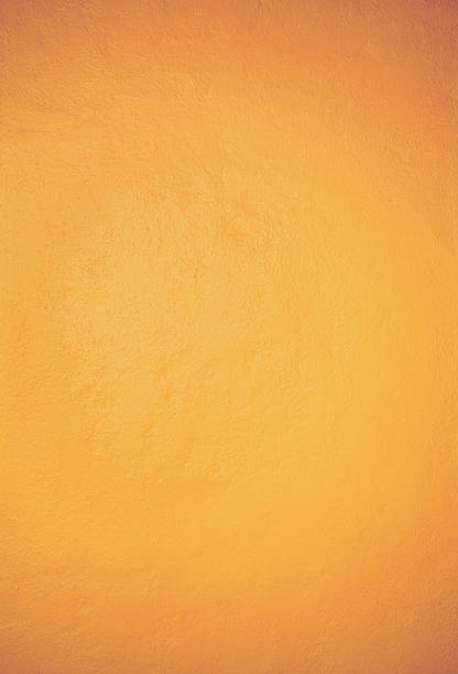 Mexican yellow rough wall stock photo