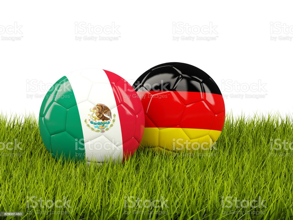 Mexico and Germany soccer balls on grass stock photo