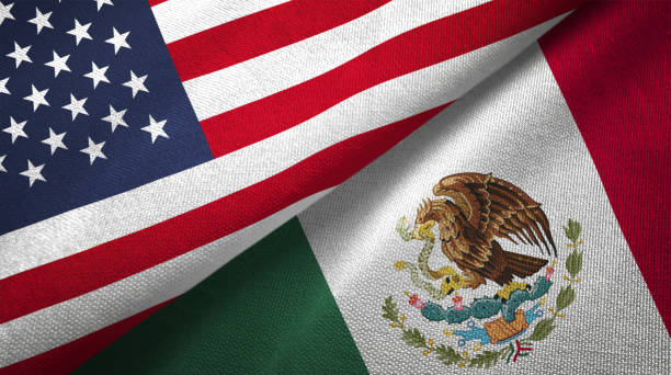 Mexico and United States two flags together realations textile cloth fabric texture Mexico and United States flags together realtions textile cloth fabric texture mexico stock pictures, royalty-free photos & images
