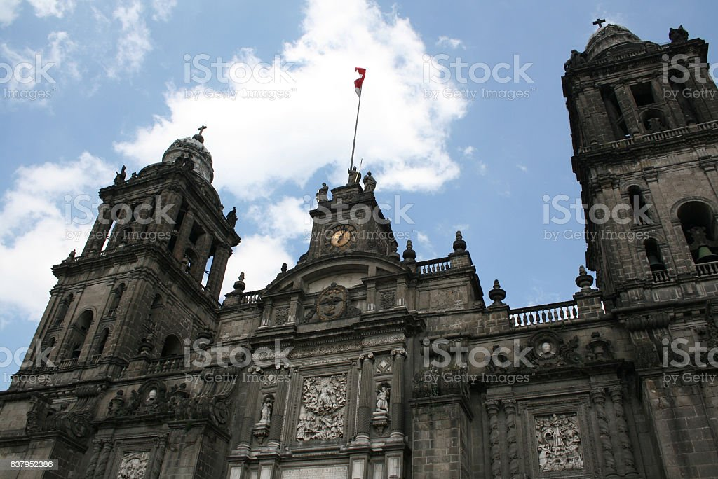 Mexico city Cathedral with flag waving. stock photo