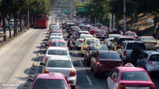 istock Mexico City Traffic Jam During Rush Hour And Tree Scene In Mexico 945285876