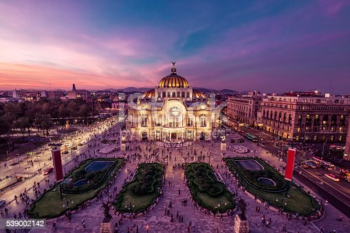 Fantastic view Mexico City's downtown at twilight. The nightlife of the city can be seen around the Palacio de Bellas Artes building in foreground.
