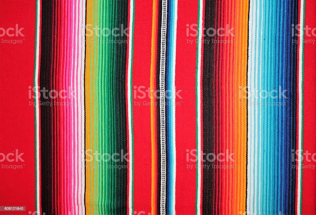 Mexico fabric poncho serape Mexican background with copy space textile stock photo
