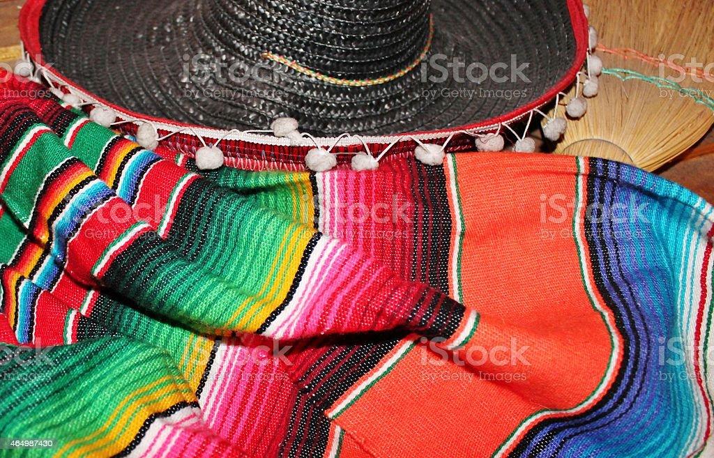 Mexico fiesta poncho serape rug blanket sombrero background stock photo