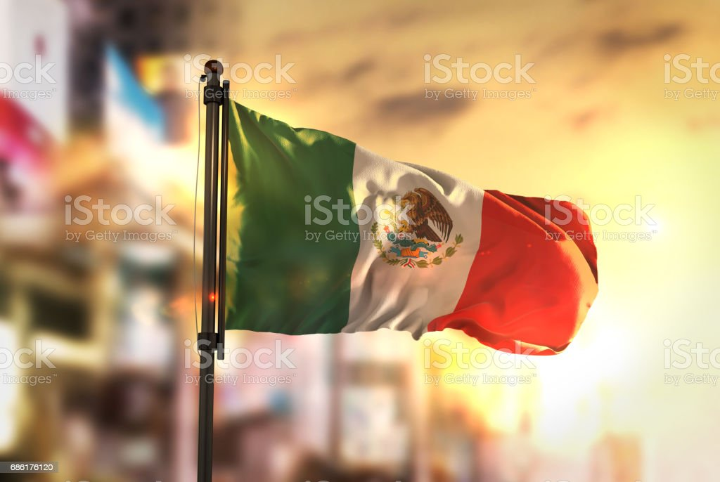 Mexico Flag Against City Blurred Background At Sunrise Backlight - foto de stock