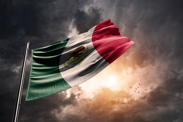 Mexico flag and a dramatic sunset stock photo