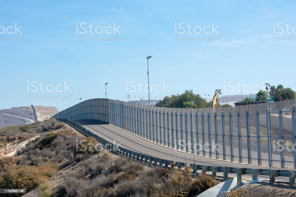 The secured border fence and road for United States border patrol...