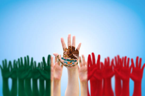 mexico national flag pattern on people hands raising up for mexican independence day celebration and cinco de mayo festival - cinco de mayo party stock photos and pictures