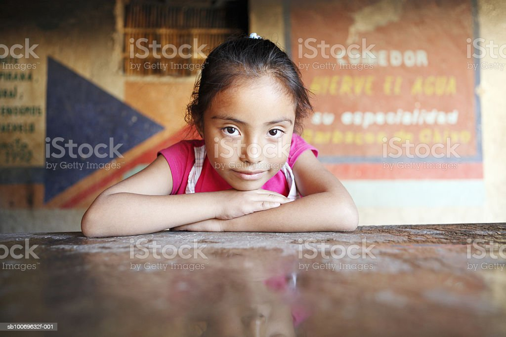 Mexico, Oaxaca, Girl (6-7) leaning on desk, portrait royalty-free stock photo