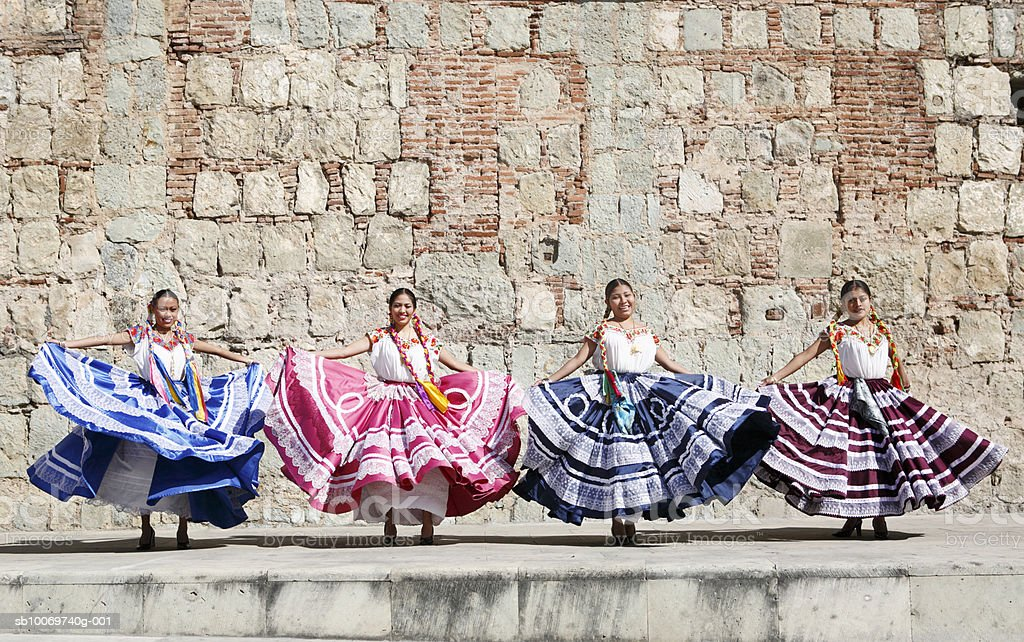 Mexico, Oaxaca, Istmo, four women in traditional dresses dancing royalty-free stock photo