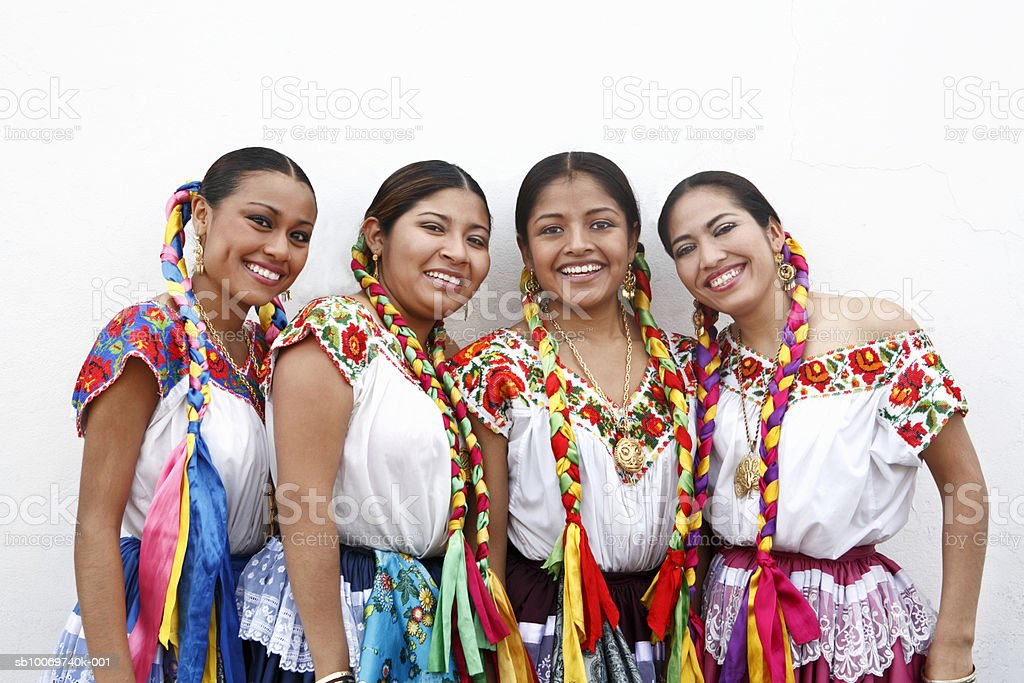 Mexico, Oaxaca, Istmo, group portrait of women in traditional clothing, outdoors royalty-free stock photo